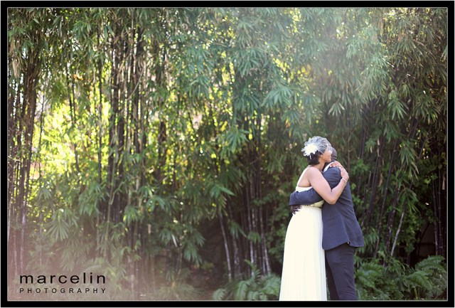 bride groom embrace at the tropical garden setting of the palms hotel