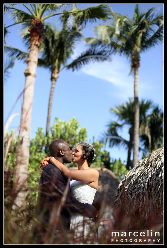 bride and groom kissing tiki hut palms hotel